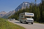 Recreational vehicle and auto traffic on 93 highway in Banff National Park, Alberta