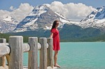 Young woman in red dress at Bow Lake in Banff National Park, Alberta