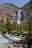 Takakkaw Falls and Yoho River pedestrian bridge in Yoho National Park, BC