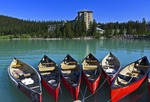 Canoes at dock near Fairmont Chateau Lake Louise Hotel in Banff National Park, Alberta