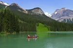 Family canoeing on Emerald Lake in Yoho National Park, British Columbia