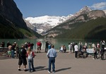 Numerous tourists are attracted to this classic view of Lake Louise in Banff National Park.