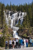 Tourists at Tangle Falls along Highway 93 in Jasper National Park, Alberta.
