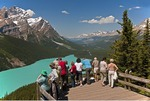 Tourists at Peyto Lake overlook in Banff National Park, Alberta.