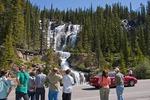 Tourists at Tangle Falls along Highway 93 in Jasper National Park, Alberta.