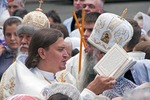 Eastern Orthodox Christian priest reading scripture at Savior of the Apple Feast Day/Feast of the Transfiguration observed simultaneously on August 19 at the Church of the Transfiguration in Odessa, Ukraine.