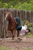 Cossack horseman at full gallop picking hat from ground in Cossack Horse Show on Khortitsa Island near Zaporozhye