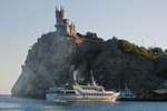 Ferry from Yalta to Swallow's Nest Castle overlooking the Black Sea on Aurora Cliff of the Ai-Tudor Cape.