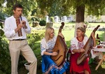 Ukrainian traditional musicians playing flute and banduras in park in Kherson, Ukraine.