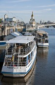 Tour boats on Dnieper riverfront near St. Nicholas Orthodox Christian Church in Kiev