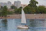 Sailboat on Dnieper River along Trukhaniv Island beach in city of Kiev.