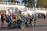 Bikers on waterfront promenade of Sevastopol harbor in summer.