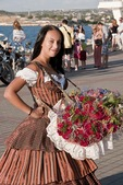 Young woman selling flowers on Sevastopol waterfront.