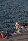 Swimmers on waterfront promenade of Sevastopol Harbor in summer.
