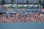 Crowded Yalta waterfront beach in summer