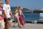 Young women fashionistas heading for the beach on the Yalta waterfront.