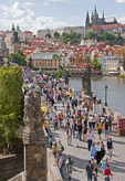 Charles Bridge crowded with pedestrians in Prague