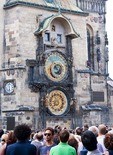 Crowd at Astronomical Clock Tower in Prague's Old Town Hall Square.