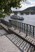 Vltava River with tour boat near Charles Bridge in Prague