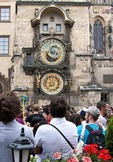 Medieval astronomical clock on Prague's Old Town Hall Tower with tourists waiting for hourly show