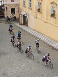 Prague bicycle tour group riding in Lesser Town (Mala Strana) near Charles Bridge