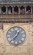 Clock on Prague's Old Town Hall Tower with tourists on observation level