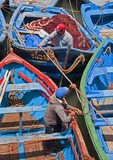 Essaouira's ancient harbor with fishermen working on their fishing boats