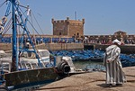Essaouira's ancient harbor with fishing boats and old Portuguese fort