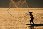 Fisherman tossing net on Mekong River at Luang Prabang, Laos