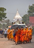 Buddhist monks leading funeral procession near Vientiane, Laos