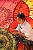 Young woman painting designs at umbrella workshop in Old Bagan, Myanmar (Burma)