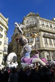 Crowded street around a falla at the annual Las Fallas Festival in Valencia, Spain.