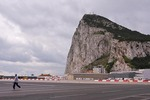 Pedestrian crossing the airport runway in Gibraltar.
