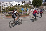 Bicyclists on roundabout in Frigiliana, Andalucian white village on Costa del Sol, Spain.