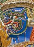 Face of giant demon (yaksha) statue guarding Wat Phra Kaew in Grand Palace in Bangkok.