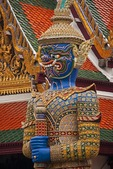 Giant demon (yaksha) statue guarding Wat Phra Kaew in Grand Palace in Bangkok.