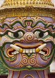 Face of giant demon (yaksha) statue guarding Wat Phra Kaew in Grand Palace in Bangkok.