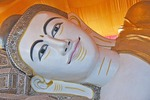 Reclining Gaudama Buddha entering Nirvanna at Shwethalyaung temple in Bago, Myanmar.