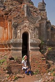 Padaung girl in doorway of ruin of ancient stupa near Indein village on Lake Inle in Shan state.