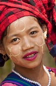 Young ethnic girl selling tourist souvenirs at Indein village on Lake Inle, Shan state, Myanmar.