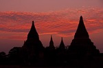 Silhouetted Buddhist pagodas on Bagan Plain at dusk in Myanmar.