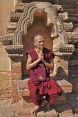 Young Buddhist monk at ruin of Sulamani Temple in Bagan.
