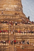 Tourists waiting to view and photograph at sunset line the Shwesandaw Pagoda on the Bagan Plain in Myanmar.