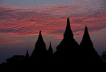 Silhouetted pagodas on Bagan Plain at dusk in Myanmar.