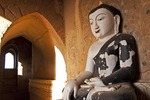Unrestored Buddha in alcove of a Bagan temple.