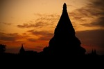 Silhouette of pagodas in Old Bagan at dusk.