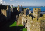 Caernarfon Castle in Gwynedd, Wales, with (l to r) Black, Chamberlain's, and Eagle Towers.