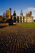 Cardiff Castle cobblestones lead to Victorian Gothic revival mansion in Cardiff, Wales.
