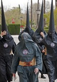 Semana Santa, (holy week) penitents (nazerenos) wearing robes and hoods in Seville, Spain.