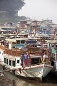 Ships docked on Ayeyarwaddy River waterfront near Mandalay, Myanmar.